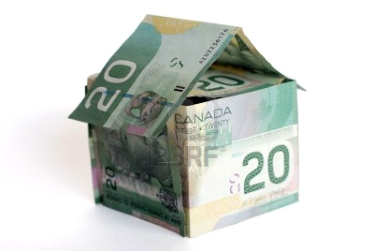818524-canadian-money-house-on-white-background